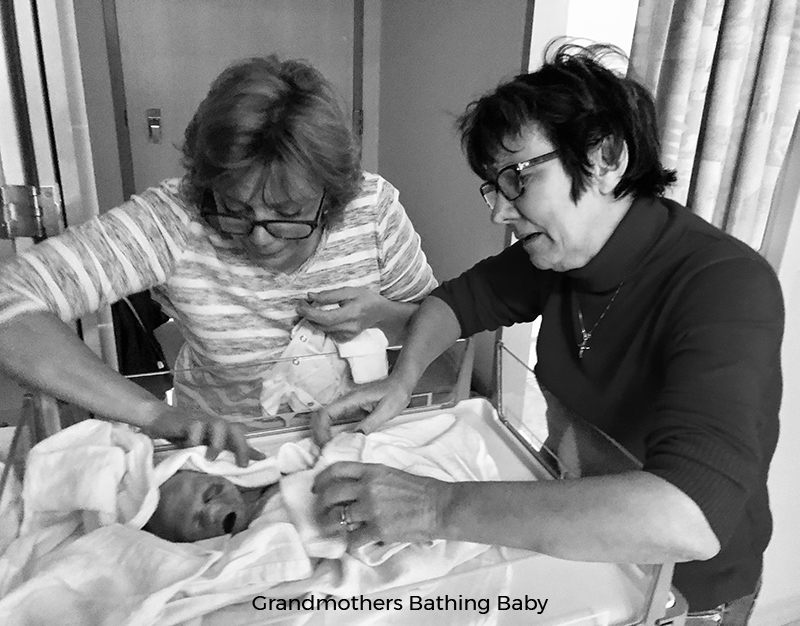 Grandmothers bathing stillborn baby